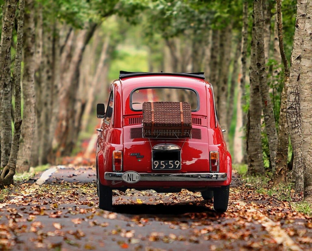 Old red Fiat 500 on a country road